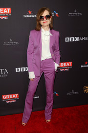 Isabelle Huppert made suiting up look so cool with this purple Gucci jacket and trouser set at the BAFTA Los Angeles Tea Party.