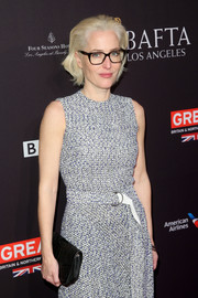 Gillian Anderson attended the BAFTA Los Angeles Tea Party sporting a black leather clutch and gray tweed dress combo.