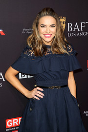 Chrishell Stause styled her dress with a skinny belt for the BAFTA Los Angeles tea party.