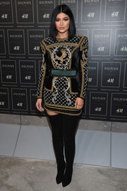 Kylie Jenner looked quite the glamazon in an ornately beaded, bold-shouldered mini dress by Balmain x H&M during the collaboration's launch.