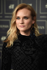 Diane Kruger looked fab with her edgy-glam waves at the Balmain x H&M collection launch.