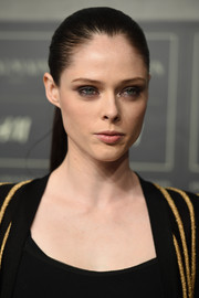 Coco Rocha slicked her hair back into a tight ponytail for the Balmain x H&M collection launch.