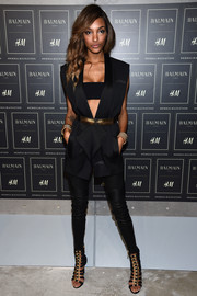 Jourdan Dunn looked fierce at the Balmain x H&M collection launch wearing a sleeveless tux jacket over a bandeau top.