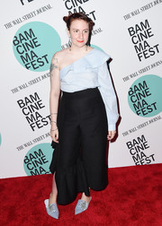 Lena Dunham continued the frilly vibe with a pair of ruffled wide-leg pants.