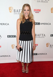 Joanne Froggatt donned a black-and-white Roland Mouret dress with a pleated skirt and peekaboo detailing for the BAFTA Los Angeles TV Tea Party.
