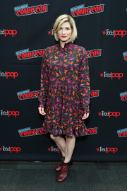 Jodie Whittaker teamed her dress with a pair of oxblood ankle boots.