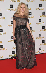 Pixie Lott hit the BBC Music Awards wearing a sheer-yoke gown adorned with a smattering of sequins.