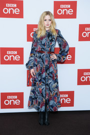 Ellie Bamber finished off her look with a pair of black mid-calf boots.