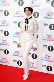 Camila Cabello paired her blouse with white leather pants, also by Philosophy di Lorenzo Serafini.