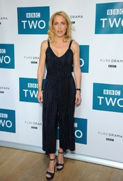 Gillian Anderson complemented her jumpsuit with a pair of blue platform sandals.