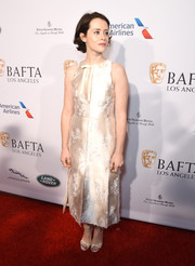Claire Foy complemented her dress with a pair of white cross-strap sandals.