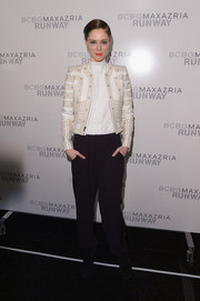 Coco Rocha cut a strong silhouette in a boxy cropped jacket during the BCBG Max Azria fashion show.