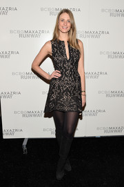 Julie Henderson added some warmth to her look with black suede knee-high boots teamed with tights.