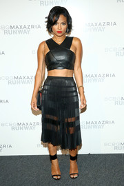 Christina Milian amped up the edge with a sheer-panel black skirt.