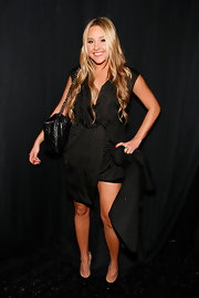 Amanda Bynes looked ready for the catwalk in a draped dress. She opted for an all-black look with a matching purse and pumps.