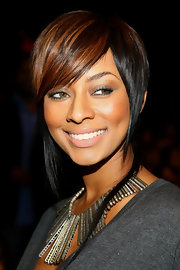 Here Keri sports an asymetrical bob with red highlights.