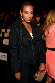Solange showed off her gold dangle earrings while hitting the BCBG fashion show.