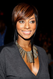 Keri Hilson added a sizzling touch to her look with metallic brown shadow.