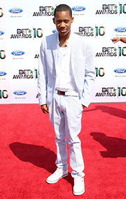 Tyler completes his all white ensemble with this white leather belt at the BET awards.