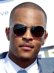 T.I. showed off his killer shades while hitting the BET Awards in a grey suit.