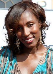 Lisa Leslie showed off her gold chandelier earrings while walking the red carpet at the BET Awards.