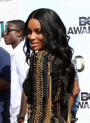 Singer Ciara topped her laced dress off with center part long curls.