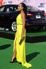 Kerry Washington accented her lime green gown at the BET Awards with a long reflective frame clutch.