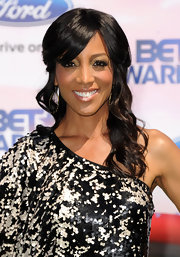 Shaun wore long curls to the BET Awards and pinned back her bangs on each side.