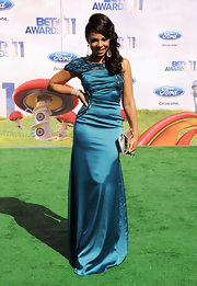 Ashanti opted for vibrant color at the 2011 BET Awards, hitting the emerald carpet in a hand-beaded turquoise silk gown from the Spring 2011 'Breeze Me' collection.