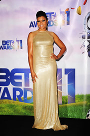 Taraji rocked a long high ponytail and a glittering gold column gown with sheer shoulder details at the BET Awards.