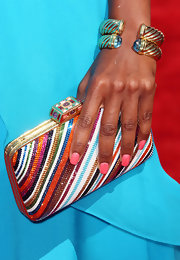 Regina King loaded up on colors when she attended the 2012 BET Awards, pairing a rainbow-beaded clutch with a pair of turquoise pants.