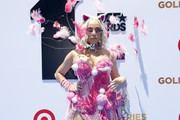 Doja Cat complemented her flirty dress with a multitude of beaded bracelets for the 2019 BET Awards.