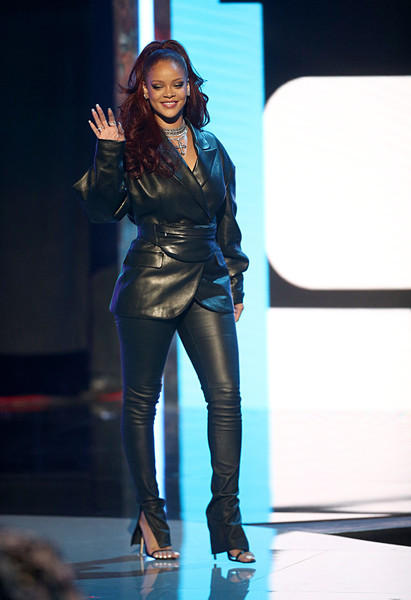 Rihanna went super edgy in a black leather pantsuit by Fenty at the 2019 BET Awards.