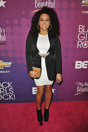 Black ankle boots added an edgy touch to Marsha Ambrosius' look.