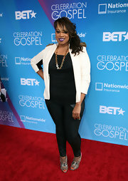 Kierra Sheard sported a white military-inspired jacket with cool gold epaulets.