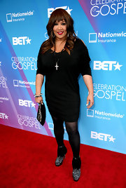 Kym Whitley opted for a cool little black dress with sleeve cutous for her red carpet look at the BET Celebration of Gospel.