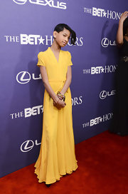 Willow Smith was summery (and surprisingly demure) in this yellow dress at the BET Honors.