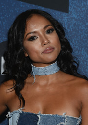 Karrueche Tran highlighted her lips with a swipe of gloss.