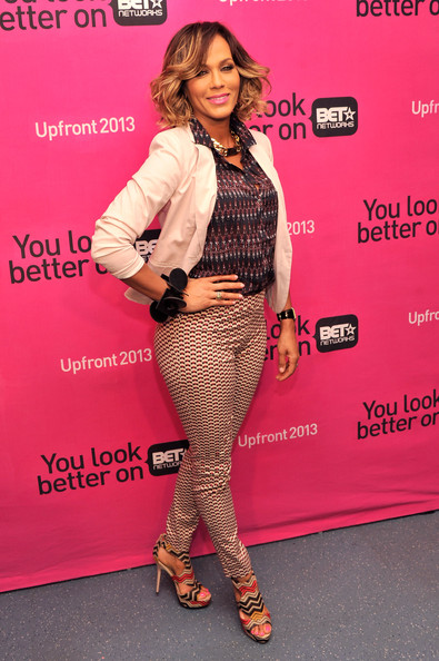 Nicole Ari Parker wasn't afraid to mix prints when she paired this black printed blouse with delicately printed pants.