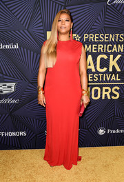 Queen Latifah opted for a simple red gown by Randi Rahm when she attended the American Black Film Festival Honors.