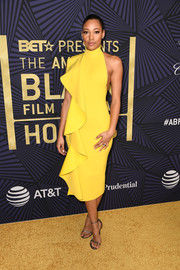 Kylie Bunbury was vibrant and sophisticated in a yellow ruffle cocktail dress by Solace London at the American Black Film Festival Honors.