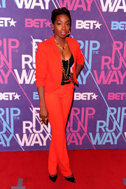 Estelle topped off her bright red pantsuit with black stilettos.