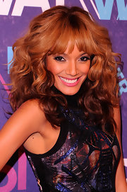 Selita Ebanks wore her her hair in bouncy voluminous curls with brow-grazing bangs at BET's 2012 Rip the Runway event.