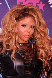 Lil Kim looked wild with her blond curly hair teased for BET's Rip the Runway 2012.