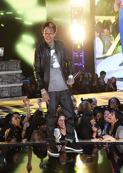 Wiz Khalifa wore a black leather jacket over his graphic tee for the BET Rip the Runway show.