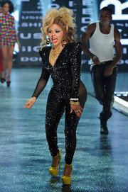 Lil Kim performed at BET's Rip the Runway wearing a sequined jumpsuit and a loud pair of platform heels.