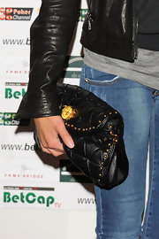 Melissa Satta carried this quilted leather bag with her jeans and matching jacket.