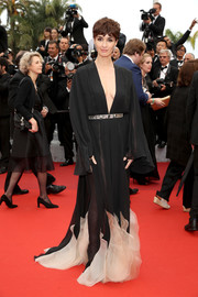 Paz Vega looked seductive on the red carpet in a sheer monochrome Stephane Rolland gown with a down-to-the-navel neckline during the Cannes premiere of 'The BFG.'