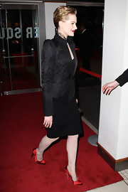 Evan Rachel Wood shined at 'The Ides of March' premiere in London. She added a pop of color to her all-black ensemble with red satin pumps.