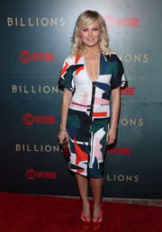 Malin Akerman injected an extra pop of color with a pair of scarlet satin pumps.
